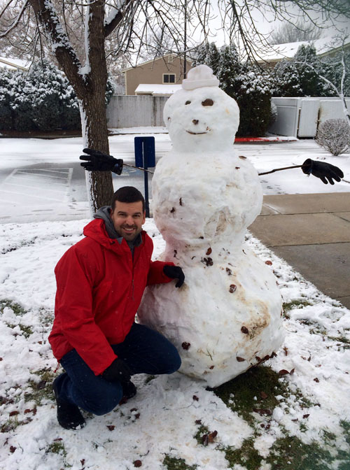 Mat next to the Snowman he built